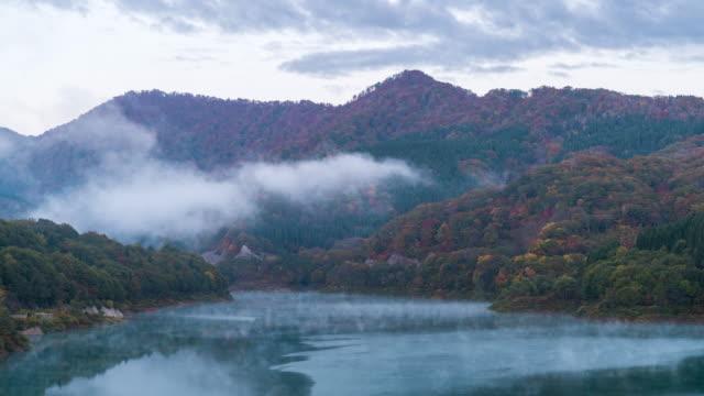 time-lapse: tamagawa dam sunrise, akita japan - maple stock videos & royalty-free footage