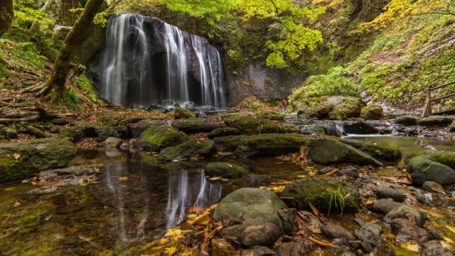 Timelapse: Tatsuzawafudo Waterfall with Autumn Leaves in Fukushima Prefecture, Tohoku, Japan
