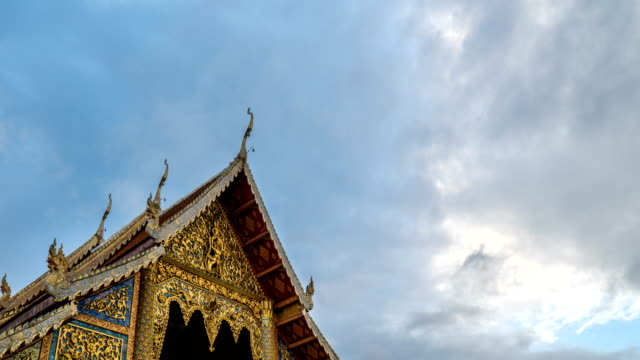 4k timelapse - thai style temple with cloudspace - monastery stock videos & royalty-free footage