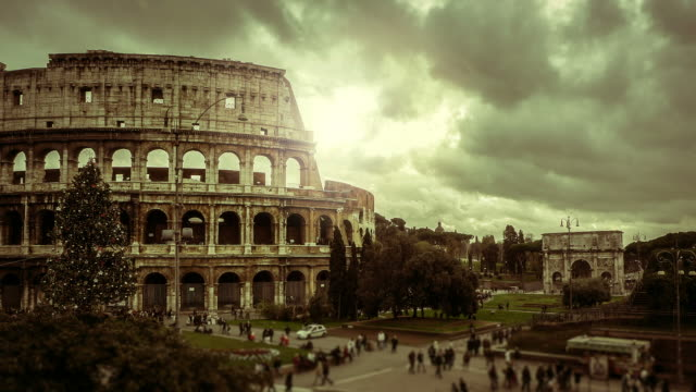 timelapse: the colosseum of rome at christmas - colosseum rome stock videos and b-roll footage