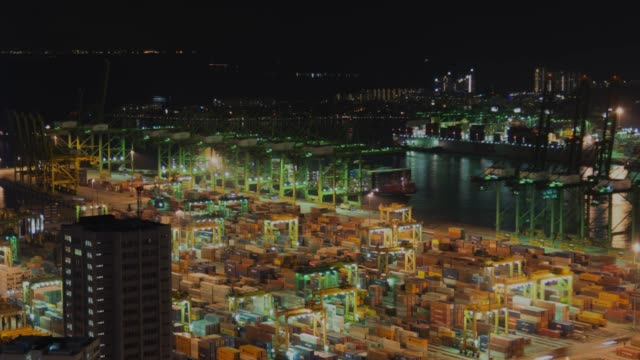 4K time-lapse: The Port of Singapore Warehouse is working import export in twilght time