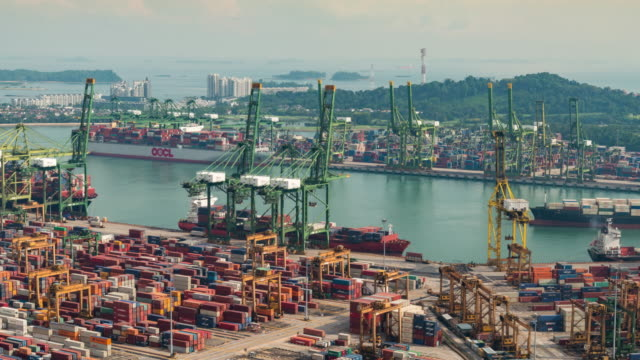 4K time-lapse: The Port of Singapore Warehouse is working import export, zoom in