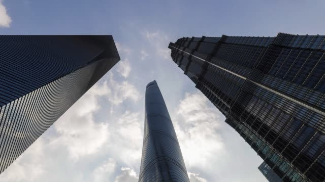 timelapse the shanghai tower center stands next to the shanghai world financial center left and the jinmao tower right in shanghai china on friday... - shanghai world financial center stock videos & royalty-free footage