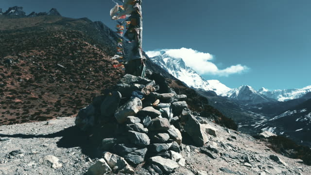 timelapse tibetan prayer flag and himalayas mountain range near dingboche village at everest region - nepali flag stock videos & royalty-free footage
