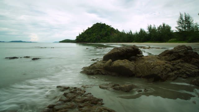 """timelapse tide goes out on sandy beach, thailand"" - receding tide stock videos & royalty-free footage"