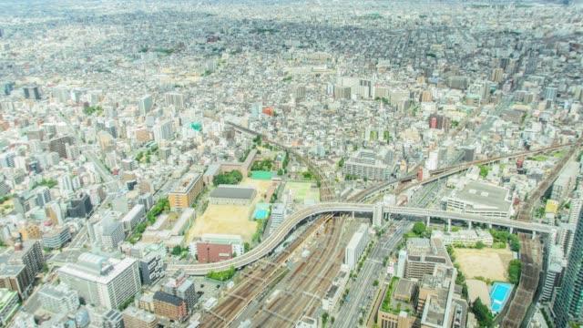 4k timelapse tilt aerial view of osaka city from abeno harukas in osaka, japan. - schrägansicht stock-videos und b-roll-filmmaterial
