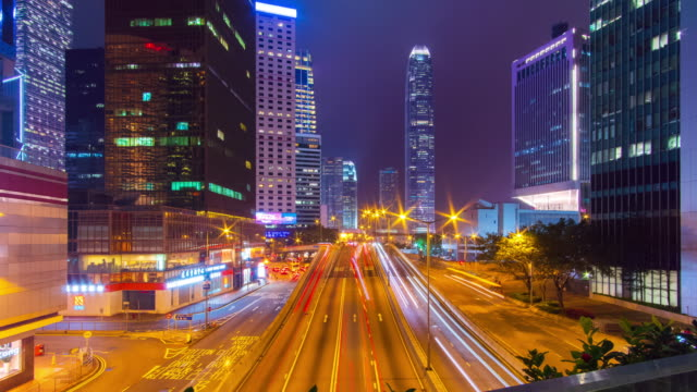 timelapse tilt down: traffic at central district in hong kong - film tilt stock videos & royalty-free footage