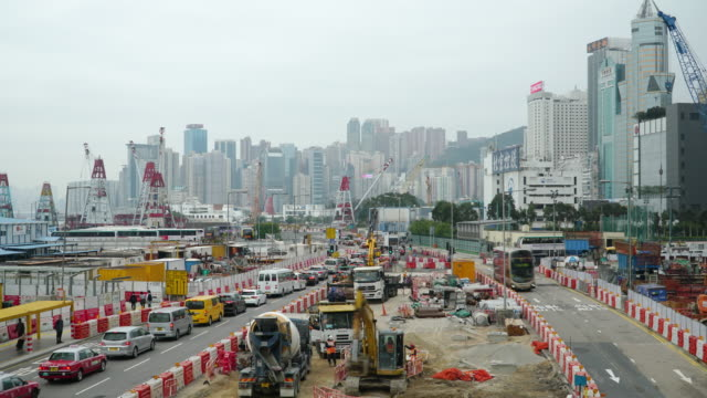 timelapse tilt down: transportation construction site working - newly industrialized country stock videos and b-roll footage
