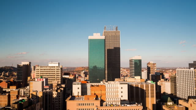 Timelapse tilt up of the city centre of Johannesburg showing the High Court of South Africa, old Sun International and Carlton Tower