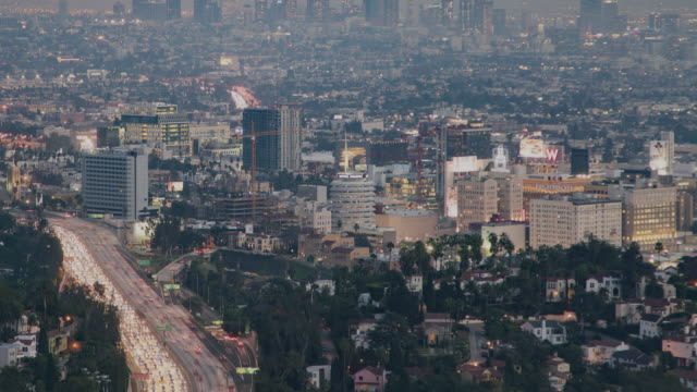 Time-lapse tilt up overlooking Hollywood, California
