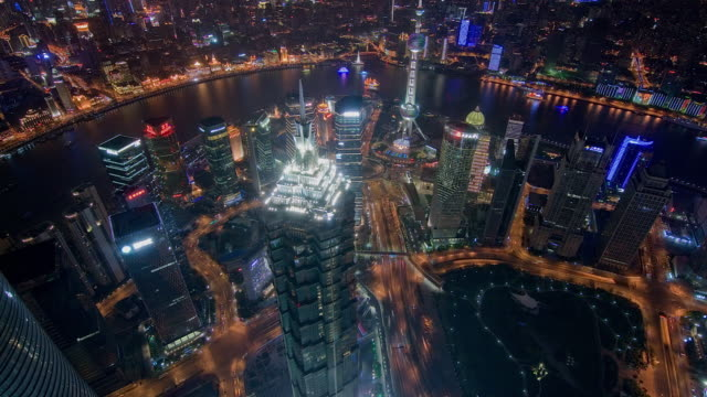 time-lapse tilt up the shanghai pudong business district and huangpu river at night - river huangpu stock videos & royalty-free footage