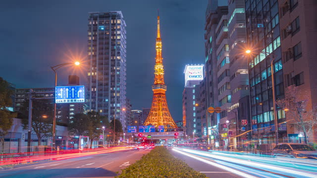 4k time-lapse tilting down of tokyo tower in japan sunset dusk is a famous place landmark - minato ward stock videos & royalty-free footage