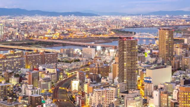 4K Time-lapse: Time-lapse: Osaka Cityscape in action at dusk