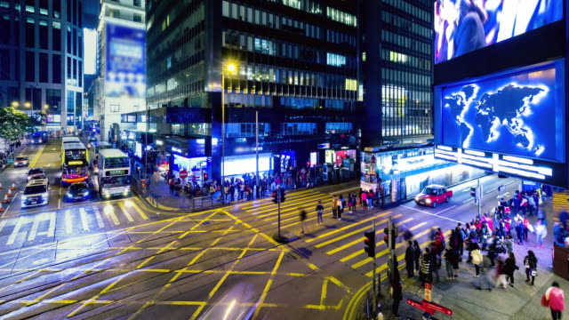 4K Timelapse : Timelapse view of people at a crossing on the streets Hong Kong city at Causway Bay. Hong Kong is a major financial hub in the Asia region.
