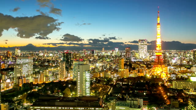 hd time-lapse: tokyo tower at dusk - tokyo japan stock videos and b-roll footage