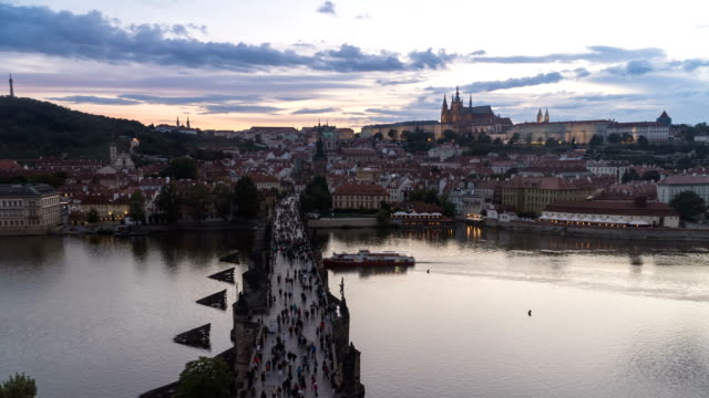 timelapse top view of charles bridge in prague during sunset, czech republic - mala strana stock videos and b-roll footage