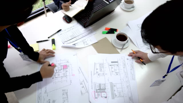 4K Timelapse - Top view of Engineering Asian Men working on home floor plans