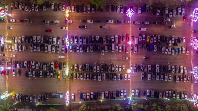 vídeos de stock e filmes b-roll de timelapse top view of parking lot in celebration event festival with colourful lighting - estacionar