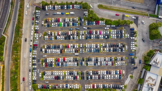 timelapse top view of the traffic at the parking lot of the shopping mall - shopping mall stock videos & royalty-free footage