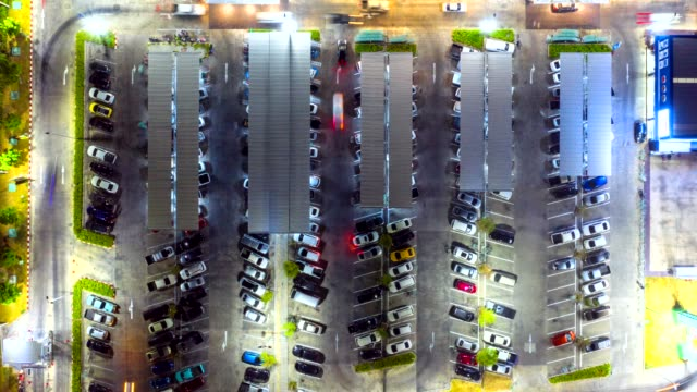 timelapse top view of the traffic at the parking lot of the shopping mall - parking stock videos & royalty-free footage