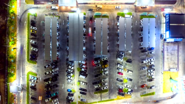 timelapse top view of the traffic at the parking lot of the shopping mall - material stock videos & royalty-free footage