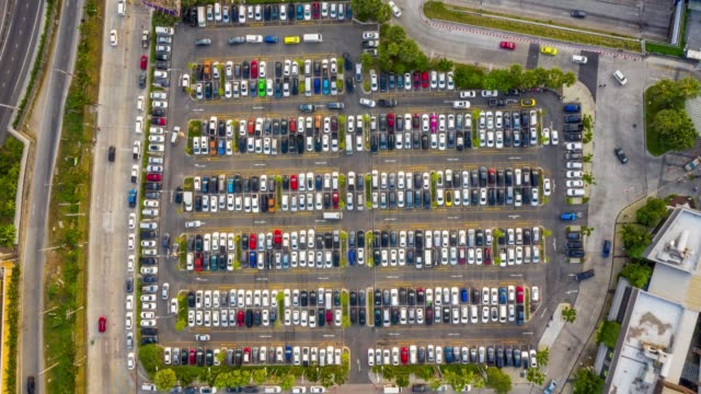 timelapse top view over outdoor parking lots - transportation building type of building stock videos & royalty-free footage