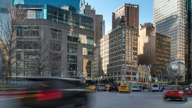 time-lapse: tourist and pedestrian crowded at broad way and columbus circle and central park corner in new york usa - cristoforo colombo video stock e b–roll