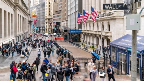 time-lapse: tourist businessman and worker pedestrian crowded at wall street new york stock exchange building usa - urban sprawl stock videos & royalty-free footage