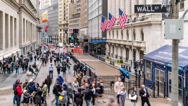 time-lapse: tourist businessman and worker pedestrian crowded at wall street new york stock exchange building usa - stock market stock videos & royalty-free footage