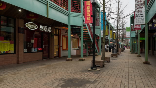 time-lapse: tourist crowd at china town in chicago downtown usa - town square stock videos & royalty-free footage