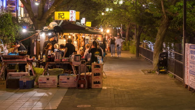 time-lapse: tourist crowd at food stall yatai naka river hakata fukuoka japan - fukuoka prefecture stock videos & royalty-free footage