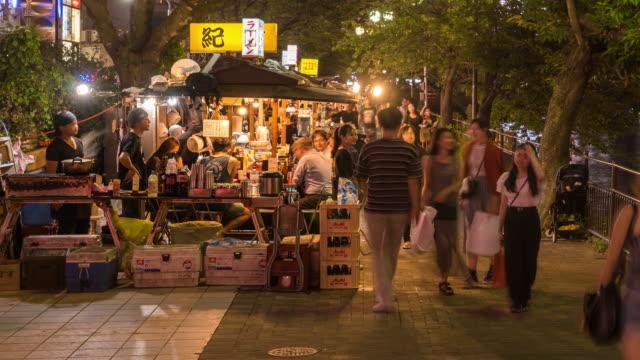 time-lapse: tourist crowd at food stall yatai naka river hakata fukuoka japan - fukuoka prefecture stock videos & royalty-free footage