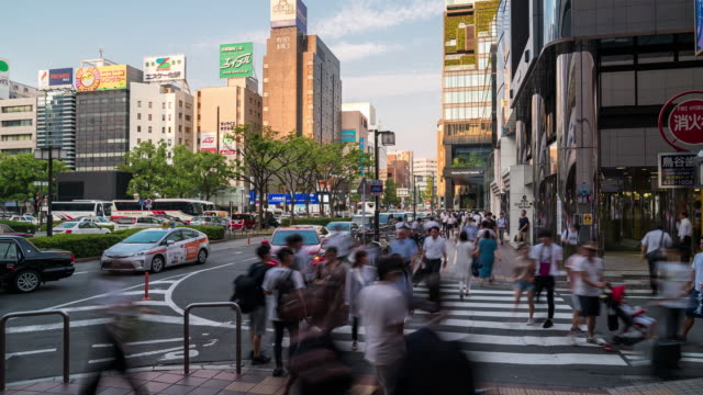 time-lapse tourist crowded and transportation at hakata in fukuoka cityscape downtown japantime-lapse tourist crowded and transportation at hakata in fukuoka cityscape downtown japan - fukuoka prefecture stock videos & royalty-free footage