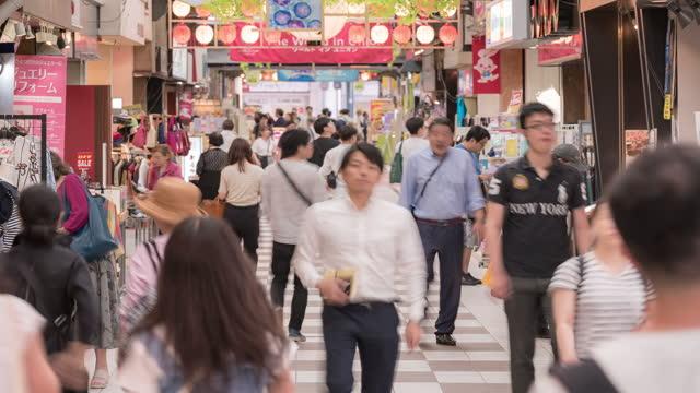 time-lapse tourist crowded at tenjin shopping street in fukuoka cityscape downtown japan - fukuoka prefecture stock videos & royalty-free footage