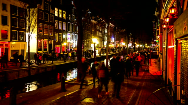 HD Time-lapse: Tourist crowed Amsterdam Red Light District night, Netherland