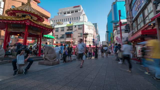 タイムラプス:日本の神戸南京町中華街に観光客の歩行者が押し寄える - 中華街点の映像素材/bロール