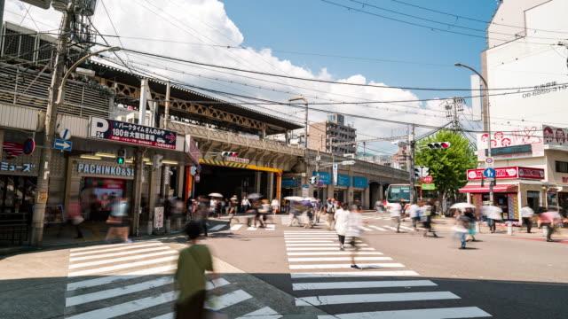 vídeos de stock, filmes e b-roll de lapso de tempo: pedestre turístico lotado na rua sannomiya shopping kobe japan - facade
