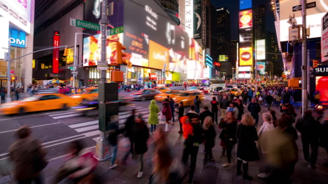 time-lapse: tourist pedestrian crowded at times square new york city at sunset night - new york city stock videos & royalty-free footage