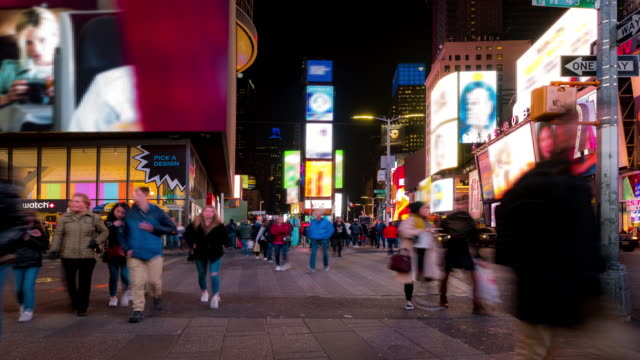 time-lapse: tourist pedestrian crowded at times square new york city at sunset night - crosswalk sign stock videos & royalty-free footage