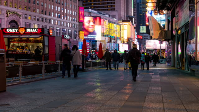 time-lapse: tourist pedestrian crowded at times square new york city at sunset night - multi layered effect stock videos & royalty-free footage