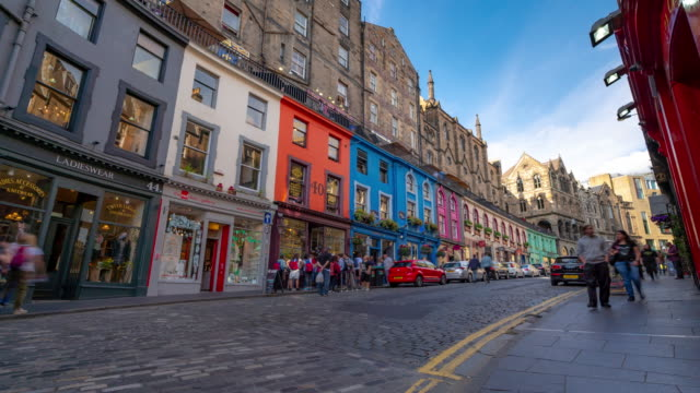 time-lapse: tourist pedestrian crowded at victoria street royal mile in old town edinburgh scotland uk - scottish culture stock videos & royalty-free footage