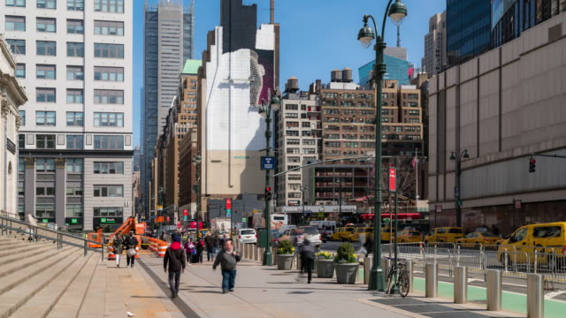 time-lapse: tourist pedestrians crowd around madison square garden pennsylvania station in new york usa - new york city penn station stock videos & royalty-free footage