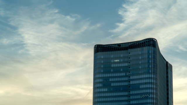 timelapse - tower with skyscape in business area, tokyo, japan - tokyo japan stock videos & royalty-free footage