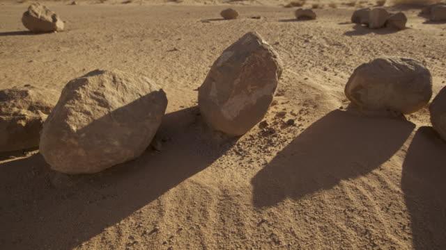 Timelapse track as rock shadows shift in desert valley, Wadi Rum, Jordan