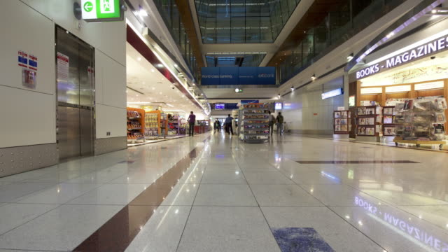 timelapse pov track through airport terminal, dubai - leaving stock videos & royalty-free footage