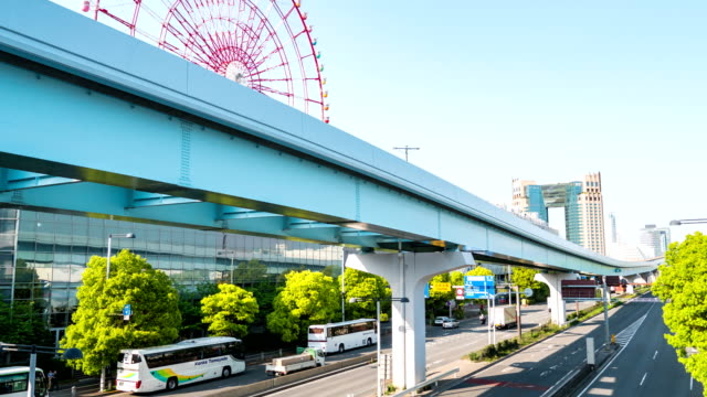 time-lapse: traffic and sky train transportation in odaiba tokyo, japan - railroad car stock videos & royalty-free footage