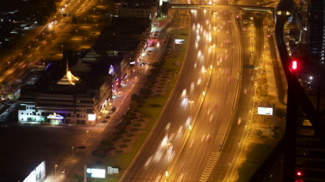 Timelapse traffic and skyscrapers on Sheikh Zayed Road at night, Dubai, UAE