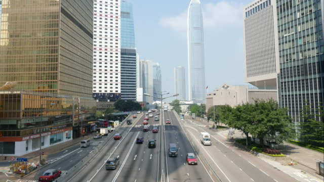 time-lapse traffic at admiralty in hong kong - toned image stock videos and b-roll footage