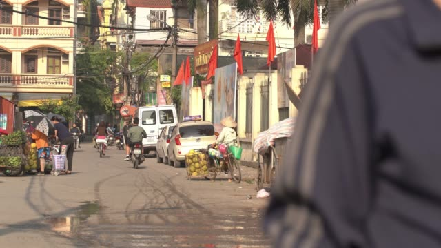4k uhd time-lapse. traffic at the street of hanoi. - pedicab stock videos & royalty-free footage