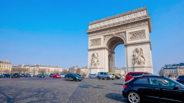 4k paris - march 23, 2015, time-lapse traffic car street in place charles de gaulle, triomphe arc etoile, triumph arch in sunny day - taxi stock videos & royalty-free footage